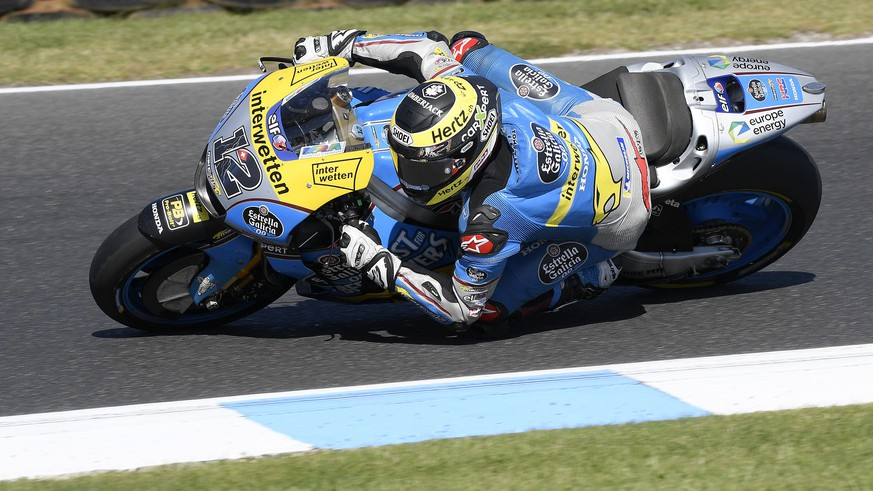 EG O,O Marc VDD rider Tom Luthi of Switzerland races through a corner during the Australian Motorcycle Grand Prix race at Phillip Island, Sunday, Oct. 28, 2018. (AP Photo/Andy Brownbill)