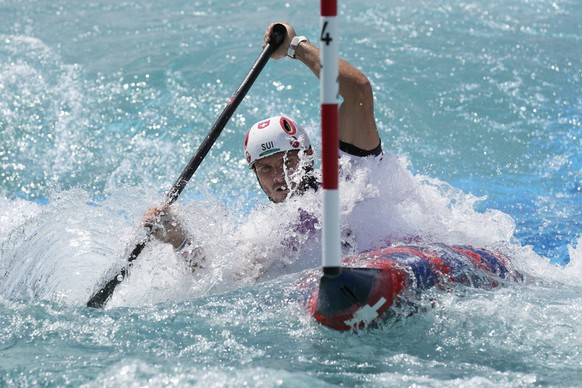 Thomas Koechlin of Switzerland competes in the Men's C1 heats of the Canoe Slalom at the 2020 Summer Olympics, Sunday, July 25, 2021, in Tokyo, Japan. (AP Photo/Kirsty Wigglesworth)