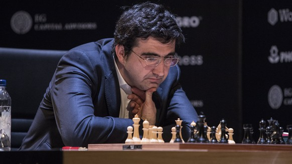 epa06632852 Russian player Vladimir Kramnik contemplates a move during a game of chess with Azerbaijani player Shakhriyar Mamedyarov (unseen), during the 14th round of the FIDE Candidates tournament in Berlin, Germany 27 March 2018.  The Candidates Tournament is an eight-player double round-robin (or all-play-all) chess competition, organized jointly by the World Chess Federation. The winner of the tournament can challenge World Chess Champion Magnus Carlsen from Norway.  EPA/OMER MESSINGER