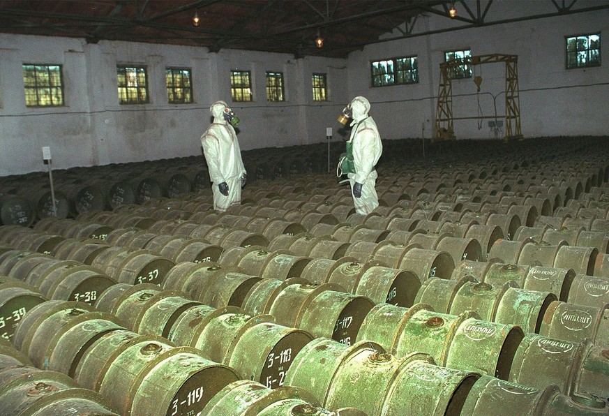FILE - In this Saturday, May 20, 2000 file photo, two Russian soldiers make a routine check of metal containers with toxic agents at a chemical weapons storage site in the town of Gorny, 124 miles (200 kms) south of the Volga River city of Saratov, Russia. The Novichok _ a lethal nerve agent that nearly killed a former Russian spy and his daughter in March and recently sickened another couple in England, is a product of a highly secretive Soviet chemical weapons program. (AP Photo, File)