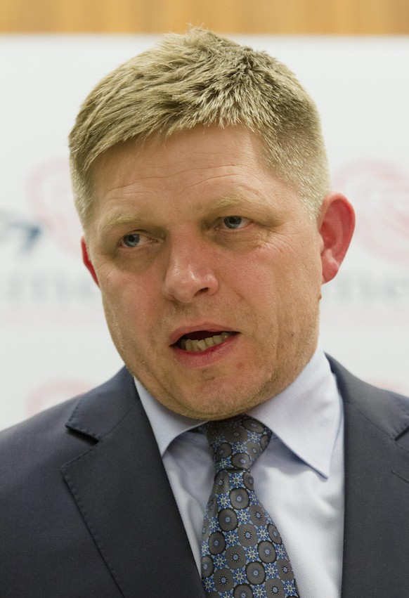epa04146491 Presidential candidate and Slovak Prime Minister Robert Fico talks to journalists after the early unofficial election results were announced after the second round of the presidential election in Bratislava, Slovakia, 30 March 2014.  EPA/Peter Hudec