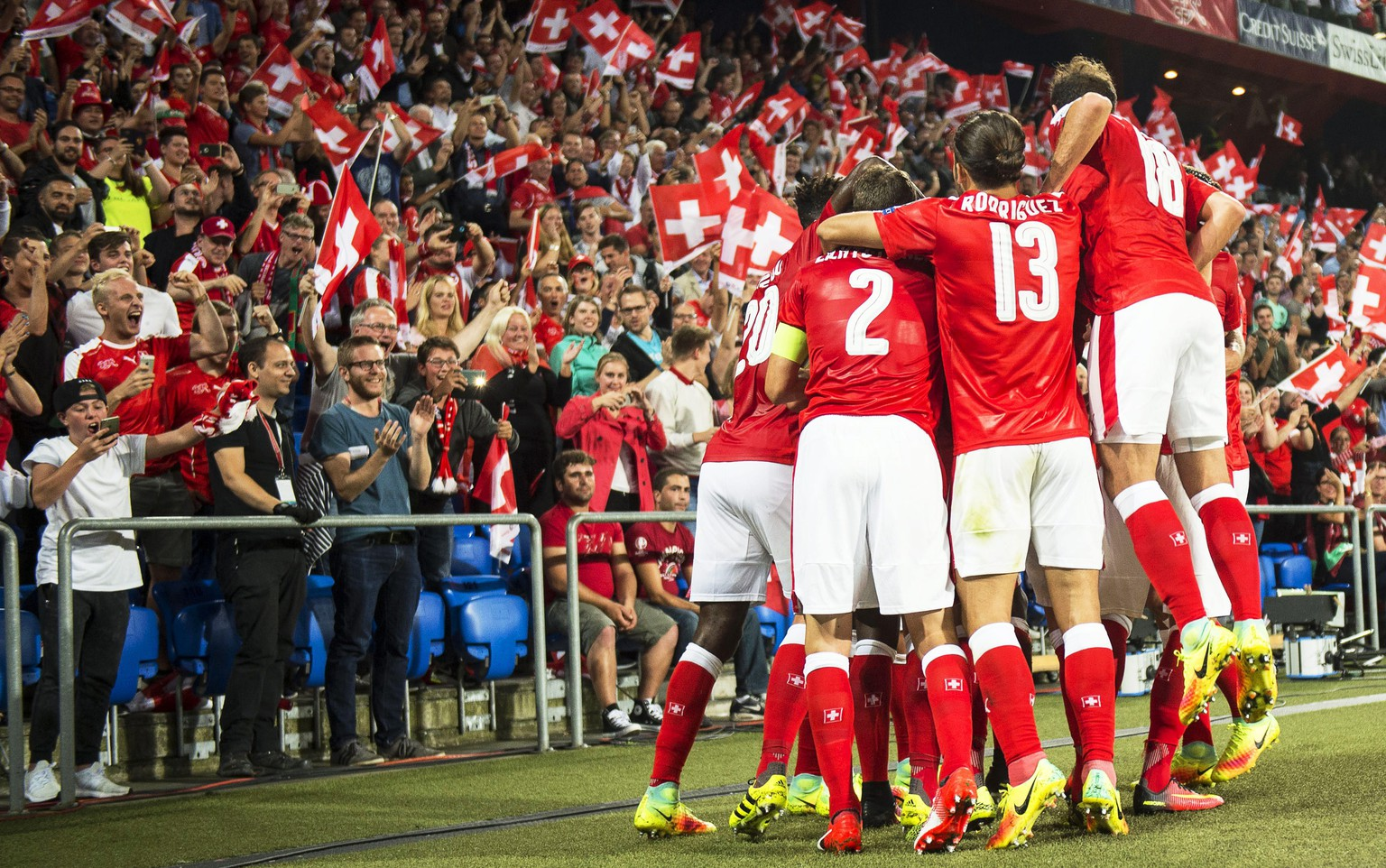 epa05527849 Swiss players celebrate their opening goal during the FIFA World Cup 2018 group B qualifying soccer match between Switzerland and Portugal at the St. Jakob-Park stadium in Basel, Switzerland, 06 September 2016. Switzerland won 2-0.  EPA/ENNIO LEANZA