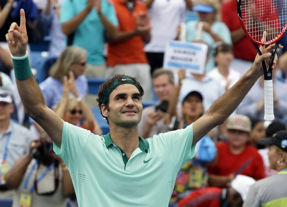 Roger Federer, from Switzerland, celebrates after defeating David Ferrer, from Spain, 6-3, 1-6, 6-2, in a final match at the Western and Southern Open tennis tournament, Sunday, Aug. 17, 2014, in Mason, Ohio. (AP Photo/Al Behrman)