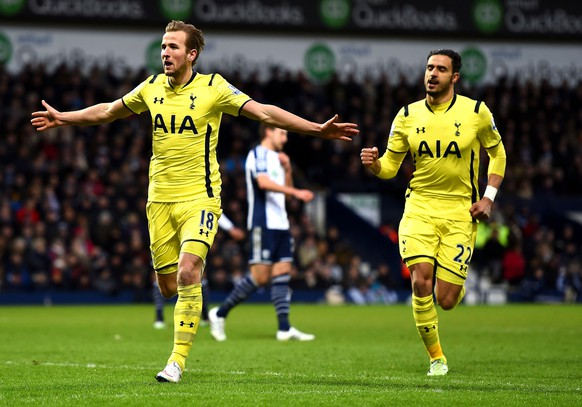 WEST BROMWICH, ENGLAND - JANUARY 31:  Harry Kane (L) of Spurs celebrates with teammate Nacer Chadli (R) of Spurs after scoring his team's third goal from the penalty spot during the Barclays Premier League match between West Bromwich Albion and Tottenham Hotspur at The Hawthorns on January 31, 2015 in West Bromwich, England.  (Photo by Laurence Griffiths/Getty Images)
