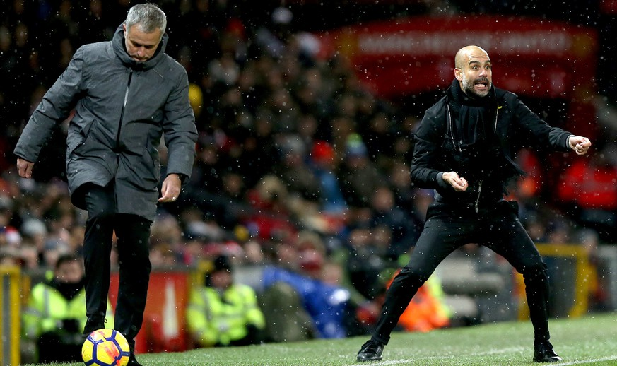 epa06381914 Manchester United's manager Jose Mourinho (L) and Manchester City's manager Pep Guardiola (R) during the English premier league soccer match between Manchester united and Manchester City at Old Trafford Stadium in Manchester, Britain, 10 December 2017.  EPA/Nigel Roddis EDITORIAL USE ONLY. No use with unauthorized audio, video, data, fixture lists, club/league logos or 'live' services. Online in-match use limited to 75 images, no video emulation. No use in betting, games or single club/league/player publications