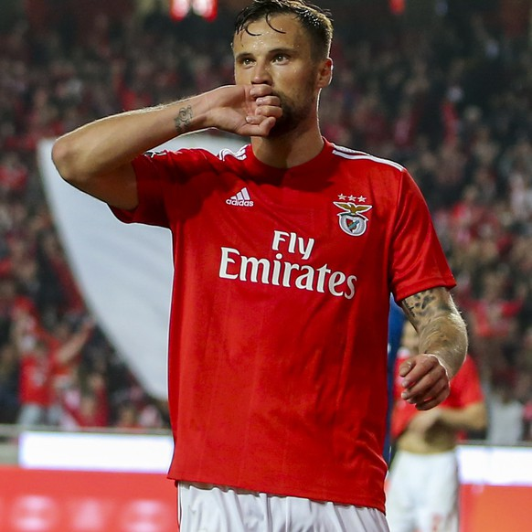 epa07507335 Benfica's player Haris Seferovic celebrates after scoring a goal during the Portuguese First League soccer match between Benfica and Vitoria de Setubal held at Luz Stadium in Lisbon, Portugal, 14 April 2019.  EPA/JOSE SENA GOULAO