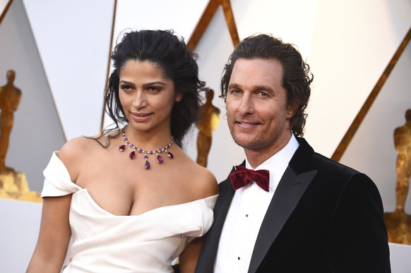 Camila Alves, left, and Matthew McConaughey arrive at the Oscars on Sunday, March 4, 2018, at the Dolby Theatre in Los Angeles. (Photo by Jordan Strauss/Invision/AP)