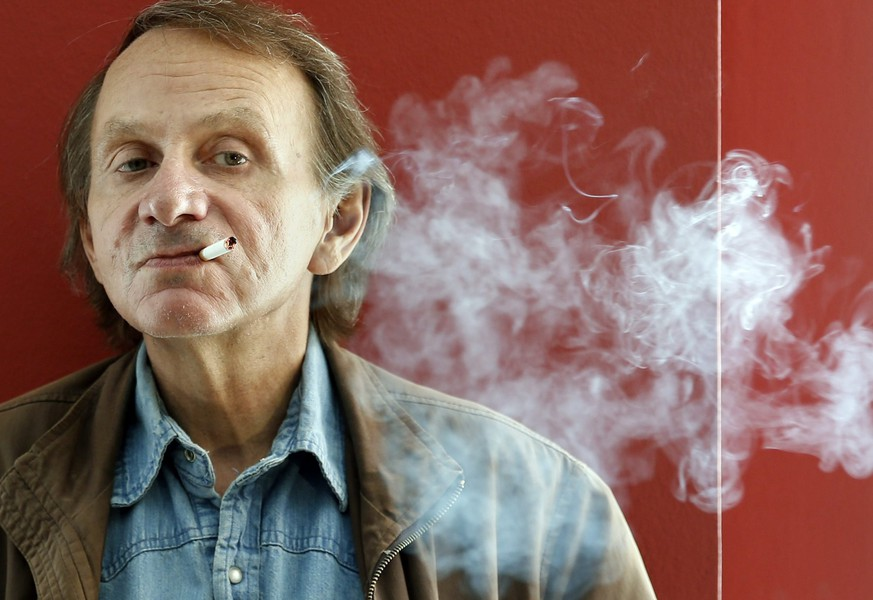 epa05169781 (FILE) A file picture dated 28 April 2015 shows French author Michel Houellebecq, posing for the media during the presentation of his latest book, 'Soumission', in Barcelona, northeastern Spain. Houellebecq will turn 60 on 26 February 2016.  EPA/ANDREU DALMAU
