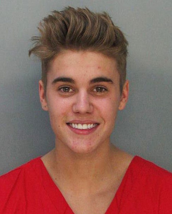 This police booking mug made available by the Miami Dade County Corrections Department shows pop star Justin Bieber, Thursday, Jan. 23, 2014. Bieber  and R7B singer Khalil were arrested for allegedly drag-racing on a Miami Beach Street. Police say Bieber has been charged with resisting arrest without violence in addition to drag racing and DUI. Police also say the singer told authorities he had consumed alcohol, smoked marijuana and taken prescription drugs. (AP Photo/Miami Dade County Jail)
