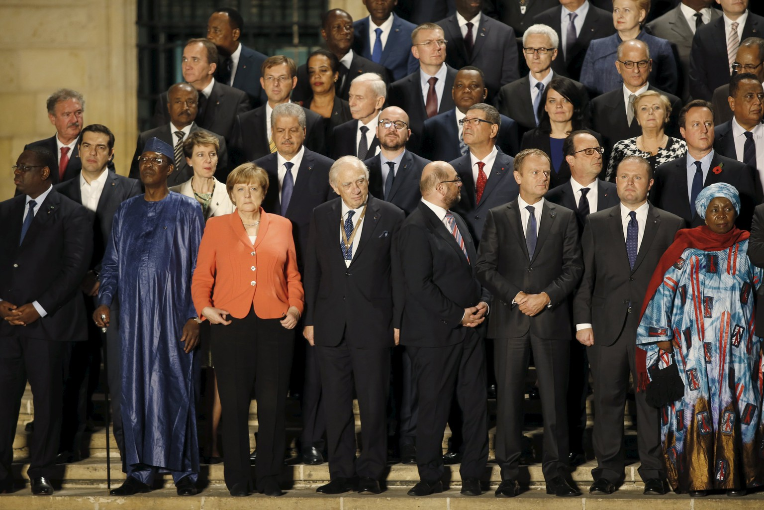 Leaders of the European Union and their African counterparts gather on the steps of the office of Malta's Prime Minister Joseph Muscat for the opening ceremony of the Valletta Summit on Migration in Valletta, Malta, November 11, 2015. Leaders of the European Union met African counterparts on Malta on Wednesday, hoping pledges of cash and other aid can slow the flow of migrants crossing the Mediterranean from the world's poorest continent to wealthy Europe.   REUTERS/Darrin Zammit Lupi MALTA OUT. NO COMMERCIAL OR EDITORIAL SALES IN MALTA.