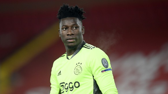 FILE - In this Tuesday, Dec. 1, 2020 file photo, Ajax's goalkeeper Andre Onana looks on during their Champions League group D soccer match against Liverpool at Anfield stadium in Liverpool, England. Onana had his ban for a positive doping test cut to nine months, and will now Nov. 3. The Court of Arbitration for Sport on Thursday, June 10, 2021 said its judges found Onana was not at significant fault and cut his one-year ban by UEFA. (Michael Regan/Pool via AP, file)