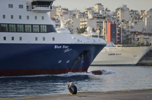 A migrant sits at a promenade of the Athens port of Piraeus, Thursday, April 7, 2016. The European Union took its first steps Wednesday toward a fundamental reform of its defective migration policy, which has heaped huge pressure on some nations like Greece as over a million migrants and refugees surged into the continent over the past year. (AP Photo/Lefteris Pitarakis)
