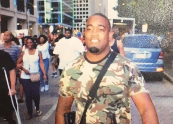 epa05414347 A handout picture released by the Dallas Police Department shows a possible suspect in the shooting of multiple police officers during a protest in Dallas, Texas, USA, 07 July 2016. According to officials, four police officers were killed and several others were wounded as it appeared that two snipers shot the police from elevated positions during a protest rally in Dallas on 07 July.  EPA/DALLAS POLICE DEPARTMENT/HANDOUT  HANDOUT EDITORIAL USE ONLY/NO SALES