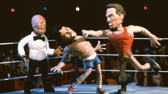 CELEBRITY DEATHMATCH (aka MTV'S CELEBRITY DEATHMATCH), from left: Mills Lane, Sylvester Stallone, Arnold Schwarzenegger, 'Arnold Schwarzenegger vs. Sylvester Stallone', (Season 1, 1998), 1998-2002, 2006-07. © MTV / Courtesy: Everett Collection