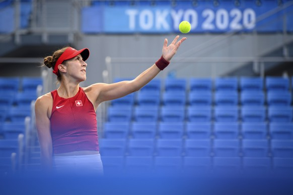 epa09361388 Belinda Bencic of Switzerland serves against Jessica Pegula of the USA during the women's single tennis first round match at the Tokyo 2020 Olympic Games, at Ariake Tennis Park in Tokyo, Japan, 24 July 2021.  EPA/LAURENT GILLIERON