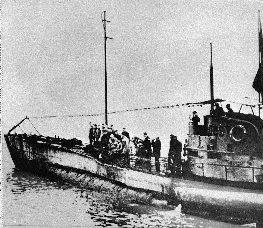 FILE - In this undated photo people stand on the deck of a World War I German submarine type UC-97 in an unknown location. Belgian regional authorities on Tuesday, Sept. 19, 2017 say that an intact German World War I submarine has been found off the coast of Belgium. (AP Photo, File)