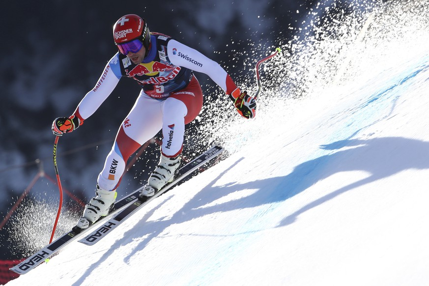 Switzerland's Beat Feuz speeds down the course during an alpine ski, men's World Cup downhill in KitzbÃ1?4hel, Austria, Friday, Jan. 22, 2021. (AP Photo/Marco Trovati)