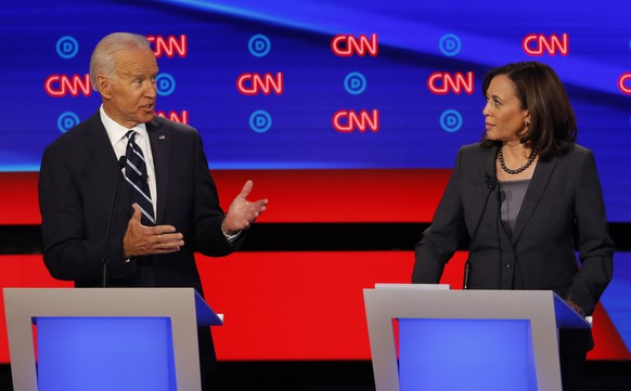 FILE - In this July 31, 2019, file photo, then-Democratic presidential candidate Sen. Kamala Harris, D-Calif., listens as Democratic presidential candidate former Vice President Joe Biden speaks during a Democratic presidential primary debate at the Fox Theatre in Detroit. Democratic presidential candidate former Vice President Joe Biden has chosen Harris as his running mate. (AP Photo/Paul Sancya, File)