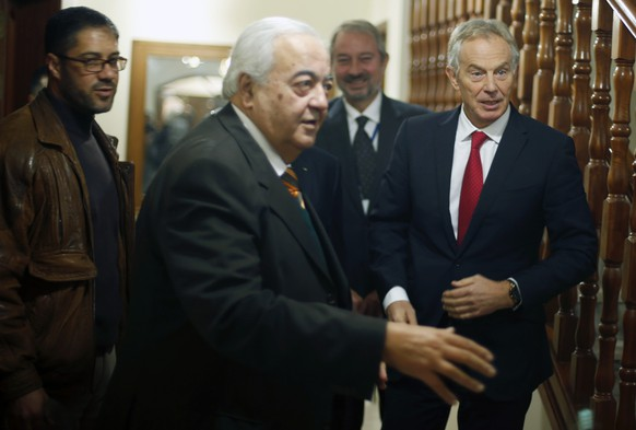 Quartet Representative to the Middle East and former British prime minister Tony Blair (R) stands next to Palestinian Minister of Work Mamoun Abu Shahla during Blair's visit to Gaza City February 15, 2015. REUTERS/Suhaib Salem (GAZA - Tags: POLITICS)