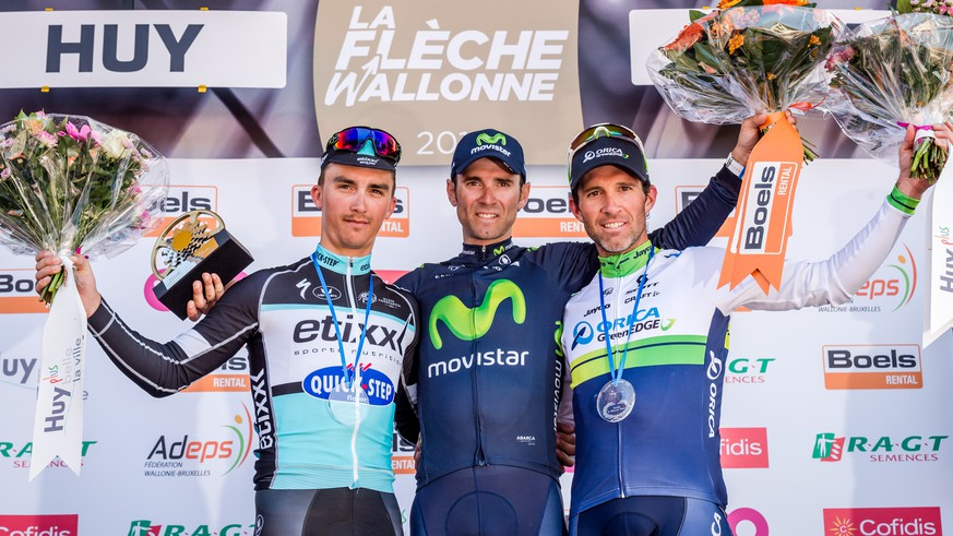 Alejandro Valverde of the Movistar team, center, stands on the podium after winning the Belgian cycling classic Walloon Arrow/Fleche Walonne together with Julian Alaphilippe of the Etixx-QuickStep team who placed second and Michael Albasini of the Orica GreenEdge team who placed third, in Huy, Belgium, Wednesday, April 22, 2015.   (AP Photo/Geert Vanden Wijngaert)