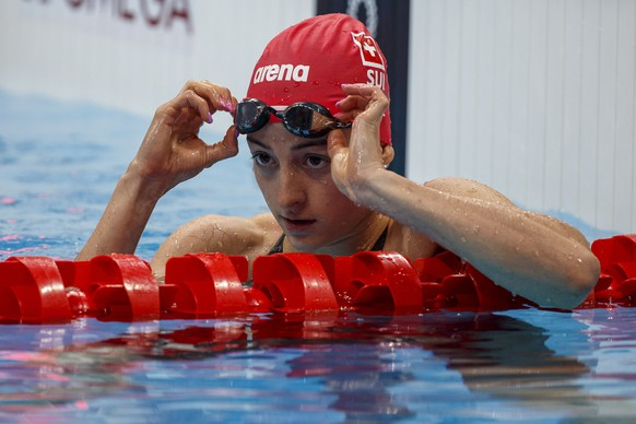 epa09364842 Lisa Mamie of Switzerland reacts after competing in the women's 100m Breaststroke Heats during the Swimming events of the Tokyo 2020 Olympic Games at the Tokyo Aquatics Centre in Tokyo, Japan, 25 July 2021.  EPA/Patrick B. Kraemer