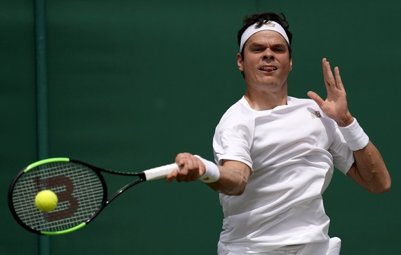 epa07697004 Milos Raonic of Canada in action against Reilly Opelka of the USA during their third round match at the Wimbledon Championships at the All England Lawn Tennis Club, in London, Britain, 05 July 2019. EPA/WILL OLIVER EDITORIAL USE ONLY/NO COMMERCIAL SALES