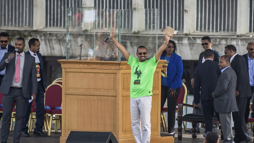 Ethiopia's Prime Minister Abiy Ahmed waves to the crowd at a large rally in his support, in Meskel Square in the capital, Addis Ababa, Ethiopia Saturday, June 23, 2018. A deadly explosion struck the huge rally for Ethiopia's reformist new prime minister on Saturday shortly after he spoke and was waving to the crowd that had turned out in numbers unseen in recent years in the East African nation. (AP Photo/Mulugeta Ayene)