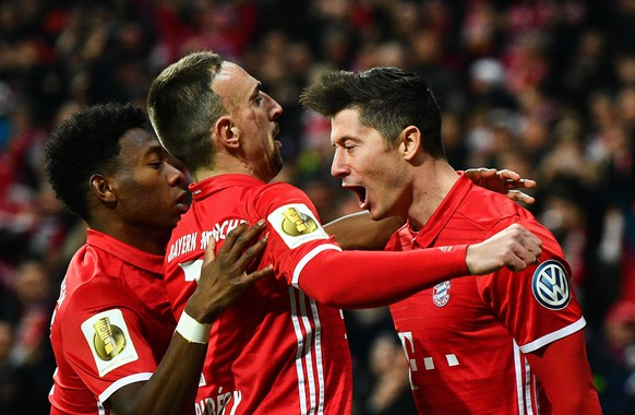 epa05823588 Bayern's Robert Lewandowski (R), Franck Ribery (C) and David Alaba celebrate the first goal during the German DFB Cup quarter final soccer match between FC Bayern Munich and FC Schalke 04 in Munich, Germany, 01 March 2017.(ATTENTION: The DFB prohibits the utilisation and publication of sequential pictures on the internet and other online media during the match (including half-time). ATTENTION: BLOCKING PERIOD! The DFB permits the further utilisation and publication of the pictures for mobile services (especially MMS) and for DVB-H and DMB only after the end of the match.)  EPA/CHRISTIAN BRUNA