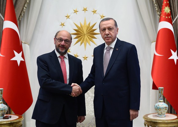 Turkey's President Recep Tayyip Erdogan, right, and European Parliament President Martin Schulz shake hands before a meeting in Ankara, Turkey, Thursday, Sept. 1, 2016. (Kayhan Ozer/Pool via AP)