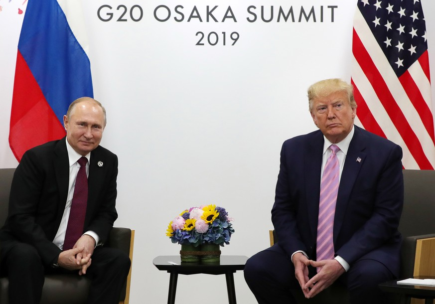 epa07753055 (FILE) - Russian President Vladimir Putin (L) and US President Donald J. Trump (R) meet on the sidelines of the G20 summit in Osaka, Japan, 28 June 2019 (reissued 02 August 2019). US formally withdraws from INF nuclear treaty with Russia on 02 August 2019.  EPA/MICHAEL KLIMENTYEV/SPUTNIK/KREMLIN / POOL MANDATORY CREDIT