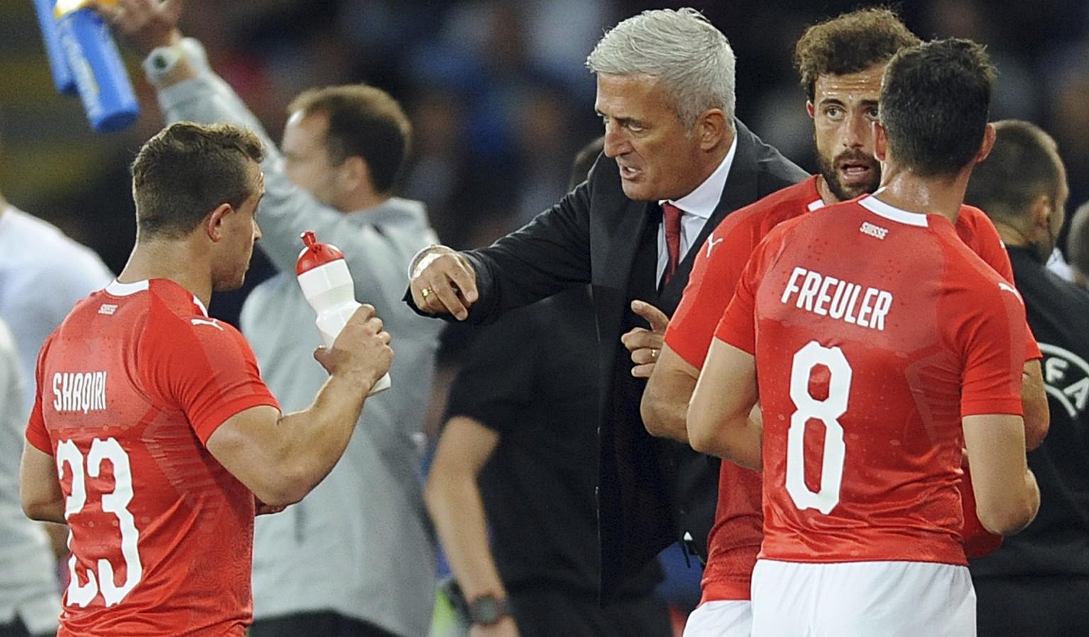 Switzerland team manager Vladimir Petkovic speaks to Switzerland's Xherdan Shaqiri , left,during the International friendly soccer match between England and Switzerland at the King Power Stadium in Leicester, England, Tuesday, Sept. 11, 2018 . (AP Photo/ Rui Vieira)