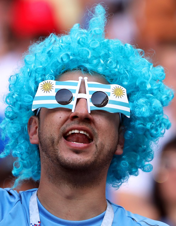 epa06824675 A supporter of Uruguay cheers for his team prior to the FIFA World Cup 2018 group A preliminary round soccer match between Uruguay and Saudi Arabia in Rostov-On-Don, Russia, 20 June 2018.  (RESTRICTIONS APPLY: Editorial Use Only, not used in association with any commercial entity - Images must not be used in any form of alert service or push service of any kind including via mobile alert services, downloads to mobile devices or MMS messaging - Images must appear as still images and must not emulate match action video footage - No alteration is made to, and no text or image is superimposed over, any published image which: (a) intentionally obscures or removes a sponsor identification image; or (b) adds or overlays the commercial identification of any third party which is not officially associated with the FIFA World Cup)  EPA/KHALED ELFIQI   EDITORIAL USE ONLY