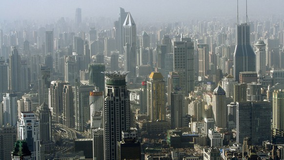 FILE - In this Dec. 22, 2005, file photo, tall buildings stand at the center of the city in Shanghai, China. The rise of industrial and financial centers like Shenzhen and Shanghai has sidelined Hong Kong in many respects. (AP Photo/Eugene Hoshiko, File)