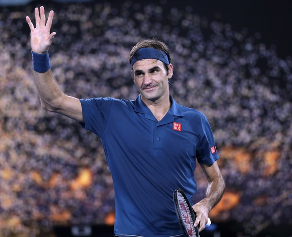 Switzerland's Roger Federer celebrates after defeating United States' Taylor Fritz during their third round match at the Australian Open tennis championships in Melbourne, Australia, Friday, Jan. 18, 2019. (AP Photo/Kin Cheung)