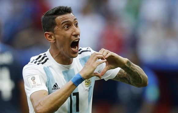 Argentina's Angel Di Maria celebrates after scoring his side's first goal during the round of 16 match between France and Argentina, at the 2018 soccer World Cup at the Kazan Arena in Kazan, Russia, Saturday, June 30, 2018. (AP Photo/Frank Augstein)