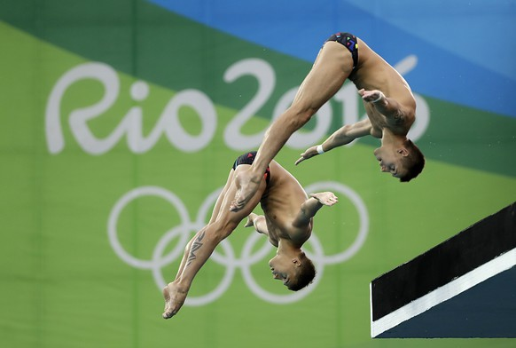Russia's Viktor Minibaev and Nikita Shleikher compete in the men's synchronized 10-meter platform diving final in the Maria Lenk Aquatic Center at the 2016 Summer Olympics in Rio de Janeiro, Brazil, Monday, Aug. 8, 2016. (AP Photo/Wong Maye-E)