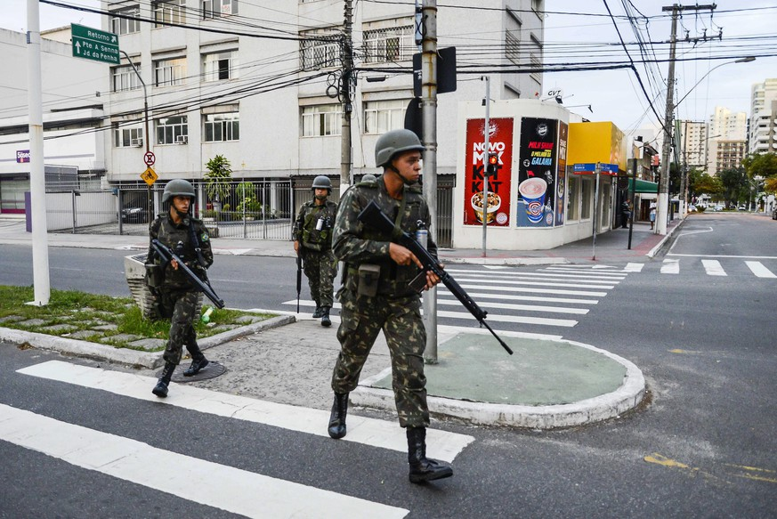 epaselect epa05775545 Members of the Brazilian army patrol the streets of Vitoria, Espirito Santo State, Brazil, 06 February 2017. The capital of the southeastern Brazilian state of Espirito Santo has reportedly experienced 52 homicides since the police went on strike at the end of last week, a union leader said. Police stopped patrolling the streets of the city on 04 February, to protest the state government's failure to invest in public safety and to value law enforcement personnel, Jorge Emiliano Legal said. Crime has surged in Vitoria, the state capital, with a record 52 violent deaths in three days, Legal said.  EPA/GABRIEL LORDELLO