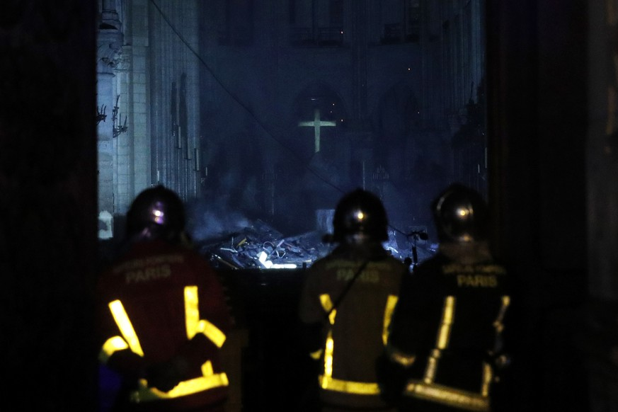 epa07509108 French firemen enter the Notre-Dame Cathedral as flames are burning the roof cathedral in Paris, France, 15 April 2019. A fire started in the late afternoon in one of the most visited monuments of the French capital.  EPA/YOAN VALAT
