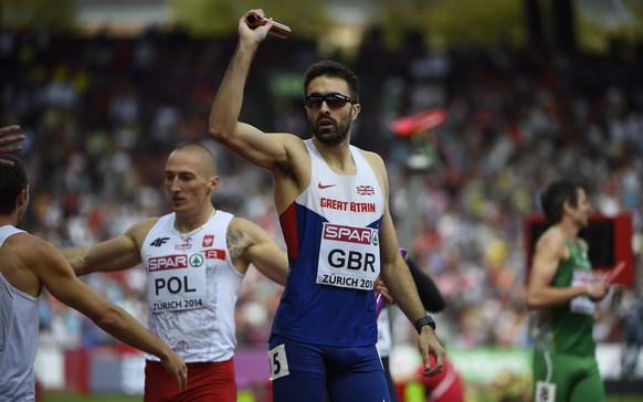 Great Britain's Martyn Rooney celebrates after he crossed the finish line to win the Men's 4x400m final during the European Athletics Championships at the Letzigrund stadium in Zurich on August 17, 2014.  AFP PHOTO / OLIVIER MORIN