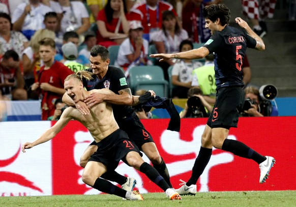 epa06872662 Domagoj Vida of Croatia (L), Dejan Lovren of Croatia (C) and Vedran Corluka of Croatia celebrate the 2-1 goal during the FIFA World Cup 2018 quarter final soccer match between Russia and Croatia in Sochi, Russia, 07 July 2018.  (RESTRICTIONS APPLY: Editorial Use Only, not used in association with any commercial entity - Images must not be used in any form of alert service or push service of any kind including via mobile alert services, downloads to mobile devices or MMS messaging - Images must appear as still images and must not emulate match action video footage - No alteration is made to, and no text or image is superimposed over, any published image which: (a) intentionally obscures or removes a sponsor identification image; or (b) adds or overlays the commercial identification of any third party which is not officially associated with the FIFA World Cup)  EPA/RONALD WITTEK EDITORIAL USE ONLY  EDITORIAL USE ONLY