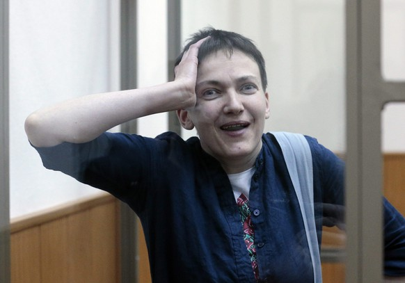 epa05224466 Former Ukrainian military pilot, Nadezhda Savchenko, reacts after hearing the first part of the verdict of her trial, in the district court of Donetsk, near the border with Ukraine, in Rostov region, Russia, 21 March 2016. Nadezhda Savchenko was found guilty of assistaning in the killing of two Russian TV journalists. The court will continue reading the verdict on 22 March. Sentencing is yet to be announced, but prosecutors have asked the court for Nadezhda Savchenko to serve 23 years in prison.  EPA/MAXIM SHIPENKOV