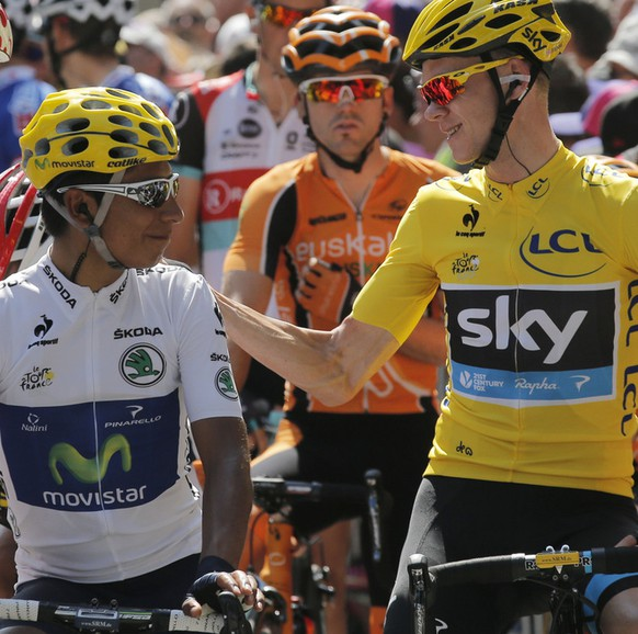 Pierre Roland of France, wearing the best climber's dotted jersey, shakes hands with Christopher Froome of Britain, wearing the overall leader's yellow jersey, as they wait with Nairo Alexander Quintana of Colombia, wearing the best young rider's white jersey, for the start of the ninth stage of the Tour de France cycling race over 168.5 kilometers (105.3 miles) with start in Saint-Girons and finish in Bagneres-de-Bigorre, Pyrenees region, France, Sunday July 7 2013. (AP Photo/Christophe Ena)