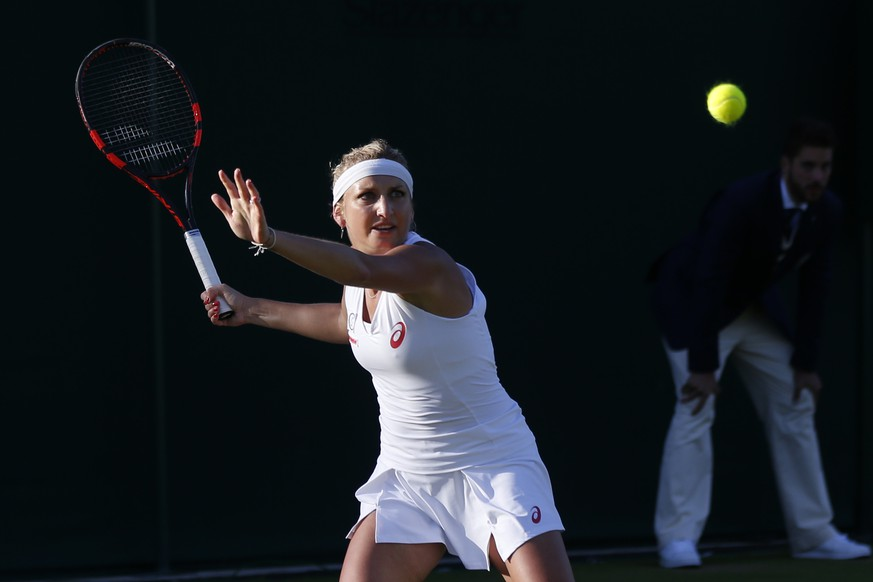 Timea Bacsinszky of Switzerland in action during her second round match against Monica Niculescu of Romania, at the All England Lawn Tennis Championships in Wimbledon, London, Friday, July 1, 2016. (KEYSTONE/Peter Klaunzer)