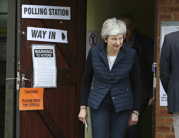 Britain's Prime Minister Theresa May leaves after casting her vote at a polling station near her home in the Thames Valley as voters headed to the polls for council and mayoral elections across England and Northern Ireland Thursday May 2, 2019. (Andrew Matthews/PA via AP)