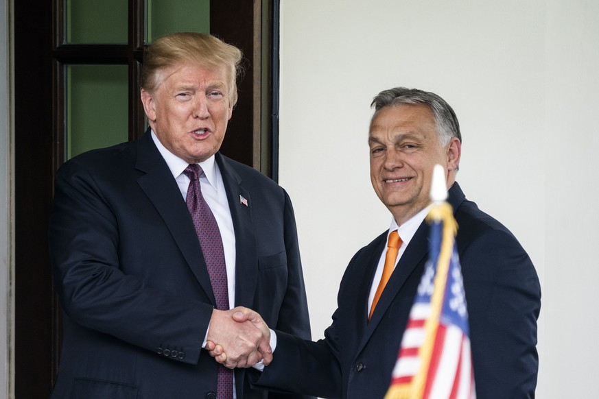 epa07567885 US President Donald J. Trump (L) welcomes Hungarian Prime Minister Viktor Orban (R) to the White House in Washington, DC, USA, 13 May 2019. Their meeting marks the first time a US president has granted Orban a formal visit in more than 20 years.  EPA/JIM LO SCALZO