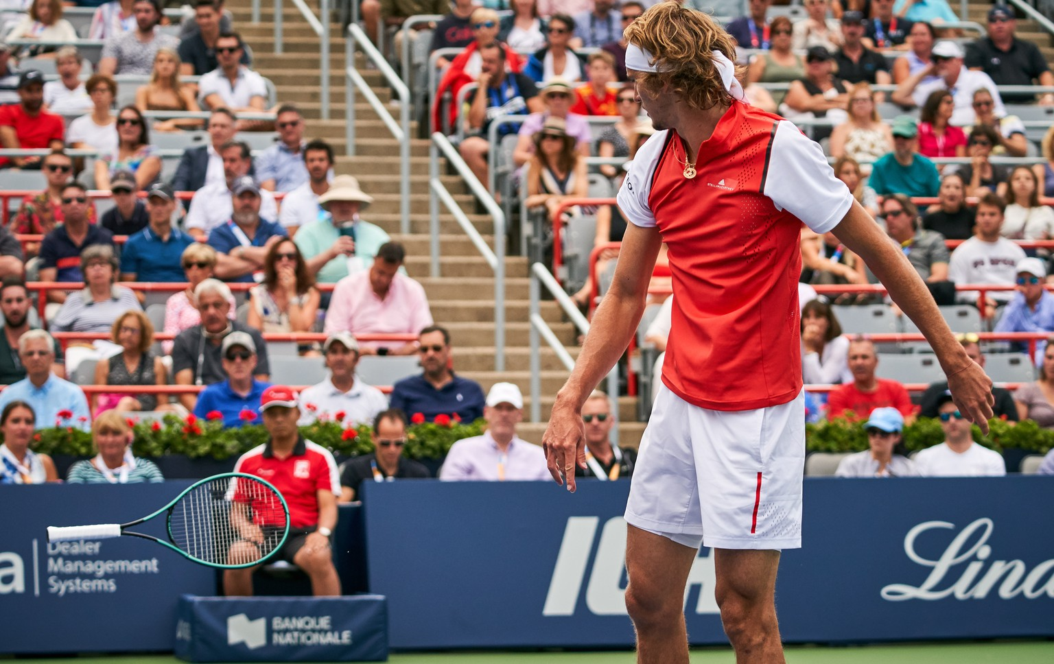 epaselect epa07765014 Alexander Zverev of Germany throws his tennis racket after he lost a set against Karen Khachanov of Russia during the Men's Singles quarter-final at the Rogers Cup tennis tournament in Montreal, Canada, 09 August 2019.  EPA/VALERIE BLUM