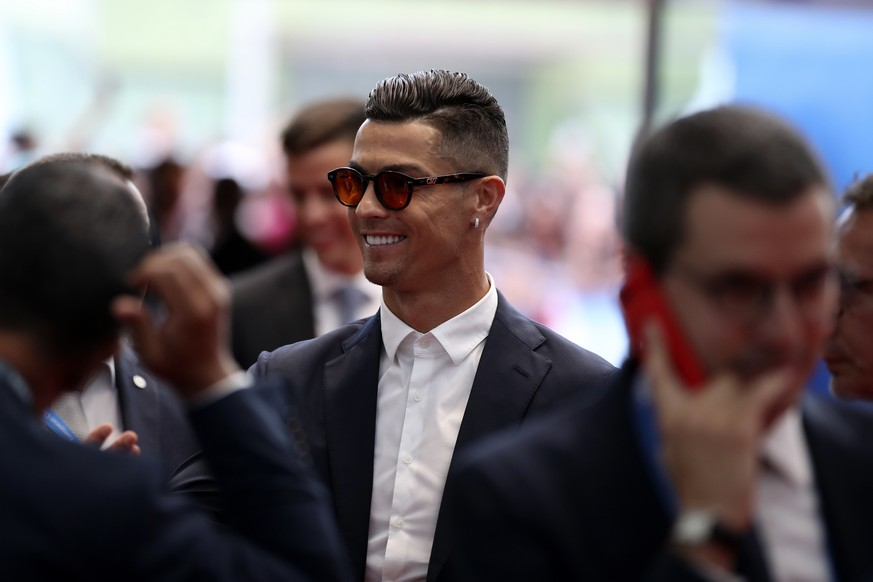 Juventus' soccer player Cristiano Ronaldo arrives for the UEFA Champions League group stage draw at the Grimaldi Forum, in Monaco, Thursday, Aug. 29, 2019. (AP Photo/Daniel Cole) Cristiano Ronaldo