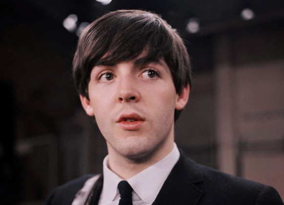 FILE - This Feb. 1964 file photo shows the Beatles' Paul McCartney on the set of the