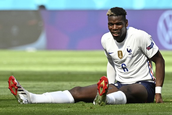 France's Paul Pogba grimaces after missing a chance to score during the Euro 2020 soccer championship group F match between Hungary and France at the Ferenc Puskas stadium in Budapest, Hungary Saturday, June 19, 2021. (Tibor Illyes/Pool via AP)