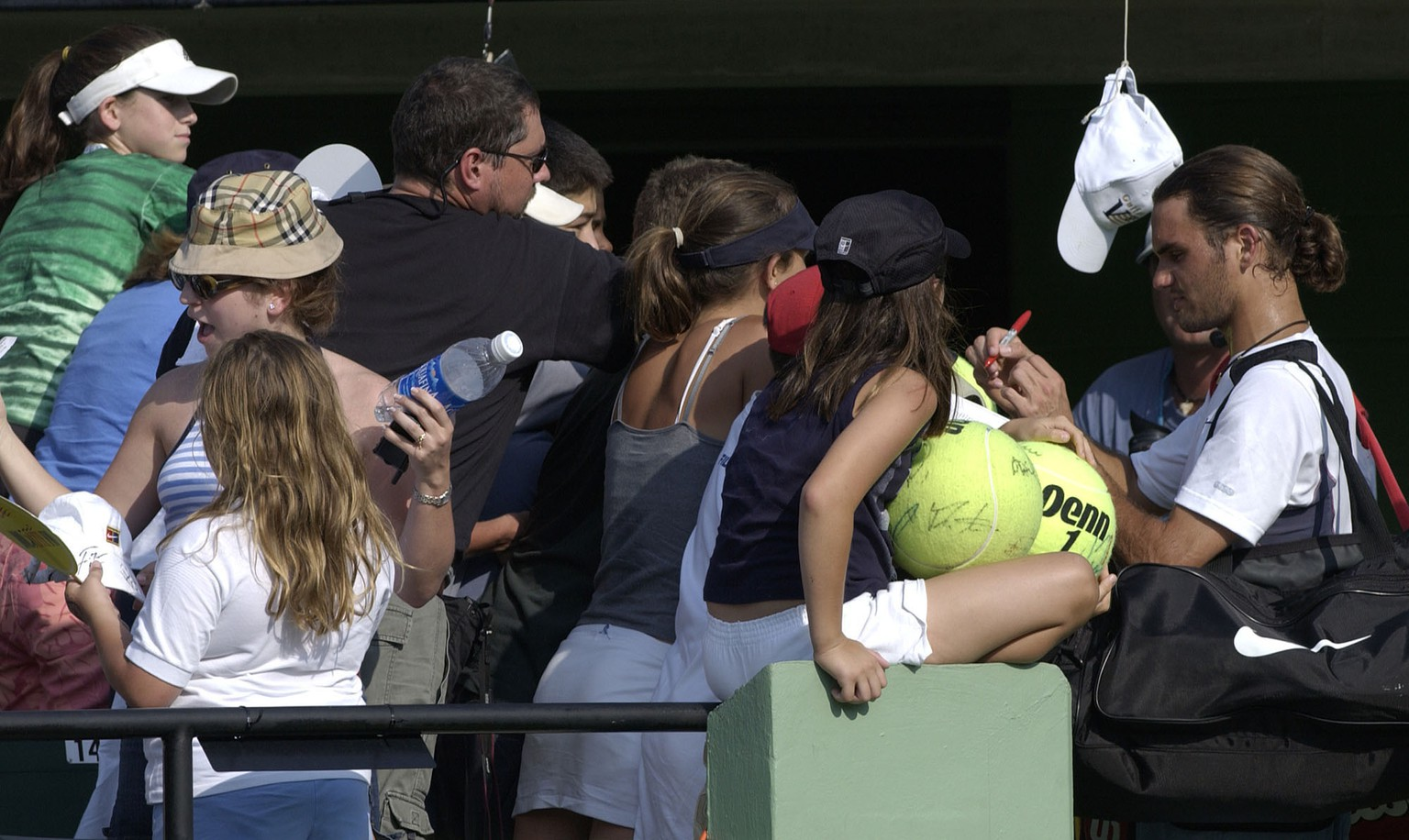 28 Mar 2002:  Roger Federer of Switzerland signs autographs after defeating Andrei Pavel of Romania during the Nasdaq-100 Open at The Tennis Center at Crandon Park in Miami, Florida. DIGITAL IMAGE Mandatory Credit: Clive Brunskill/Getty Images